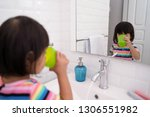 kid wash her mouth or gargle... | Shutterstock . vector #1306551982