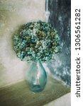 Dry Hydrangea In A Glass Blue...