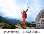 woman hiker with backpack... | Shutterstock . vector #1306580818
