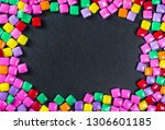 lies a lot of rainbow colored... | Shutterstock . vector #1306601185