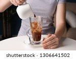 woman making tasty frappe... | Shutterstock . vector #1306641502