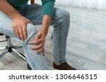 man suffering from leg pain... | Shutterstock . vector #1306646515