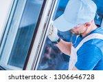 caucasian windows technician... | Shutterstock . vector #1306646728