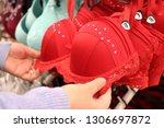 woman chooses red lace bra... | Shutterstock . vector #1306697872