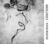 Abstract black smoke swirls over grunge background