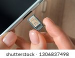 woman inserting sim card into...   Shutterstock . vector #1306837498