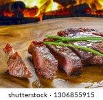 steak sirloin against bbq beef  | Shutterstock . vector #1306855915