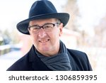 portrait of a senior with hat | Shutterstock . vector #1306859395