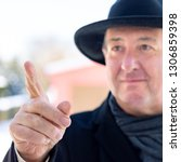 finger pointing of man with hat | Shutterstock . vector #1306859398