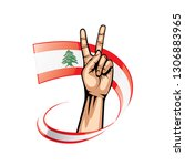 lebanese flag and hand on white ... | Shutterstock .eps vector #1306883965