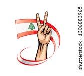 lebanese flag and hand on white ... | Shutterstock .eps vector #1306883965