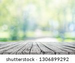 wooden table and spring nature... | Shutterstock . vector #1306899292
