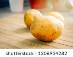 still life of raw potatoes on a ... | Shutterstock . vector #1306954282