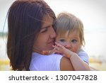 love and tender hugs of mother... | Shutterstock . vector #1307047828