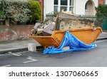large orange metal skip... | Shutterstock . vector #1307060665