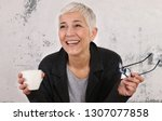 happy laughing mature woman... | Shutterstock . vector #1307077858