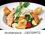 caesar salad with salmon. fried ... | Shutterstock . vector #130709972