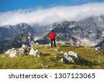 hiker in red jacket enjoying at ... | Shutterstock . vector #1307123065