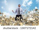 businessman exults over a lot... | Shutterstock . vector #1307172142