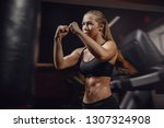 young female boxer in motion to ... | Shutterstock . vector #1307324908