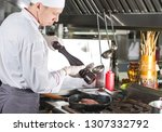 chef in restaurant kitchen at... | Shutterstock . vector #1307332792