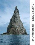 steep rock spire rising from... | Shutterstock . vector #1307351542