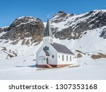 a small church with spire set... | Shutterstock . vector #1307353168