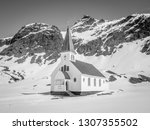 a small church with spire set... | Shutterstock . vector #1307355502