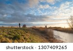 woman cycling in the dutch... | Shutterstock . vector #1307409265