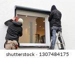 worker installing a roller... | Shutterstock . vector #1307484175