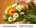 bouquet of white and orange... | Shutterstock . vector #1307513185
