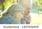 sad senior wife embracing... | Shutterstock . vector #1307656435