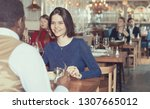 lovely couple is dining... | Shutterstock . vector #1307665012