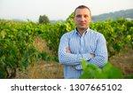 man proffesional winemaker... | Shutterstock . vector #1307665102