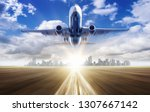 take off of an airplane against ... | Shutterstock . vector #1307667142