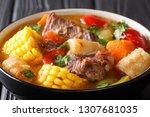 sancocho is a traditional soup... | Shutterstock . vector #1307681035