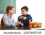 little boy sharing his school... | Shutterstock . vector #1307685745