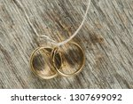 two gold wedding rings tied... | Shutterstock . vector #1307699092