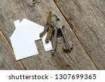 house icon and keys on wooden... | Shutterstock . vector #1307699365