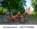 two orange bicycles parked... | Shutterstock . vector #1307733088