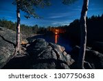 camp fire in the forest near... | Shutterstock . vector #1307750638