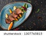 juicy duck breast steaks with... | Shutterstock . vector #1307765815