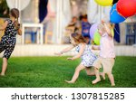 little boy and girl having fun... | Shutterstock . vector #1307815285