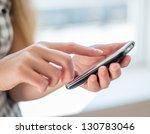 young beautiful woman writes an ...   Shutterstock . vector #130783046