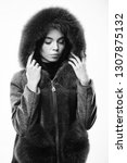 woman wear hood with fur.... | Shutterstock . vector #1307875132