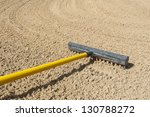 rake in a bunker on golf course