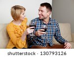Young couple drinking wine at home. - stock photo