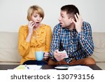 Shocked couple paying bills. She just buy too much. - stock photo