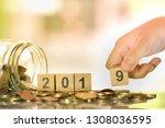 kid's hand holding wooden... | Shutterstock . vector #1308036595