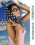brunette in the wind wearing a... | Shutterstock . vector #13080514